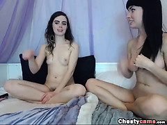 Two brunette teens playing