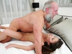 A bimbo that loves old men is fucked on the bed deeply
