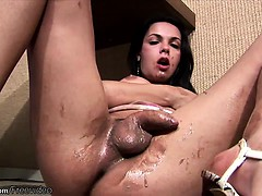 Big ass feminine tranny squirts whipped cream inside her ass