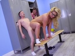 A blonde with huge boobs and glasses is fucked in the locker room