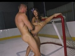 A bimbo gets penetrated on ice in the hockey ring by her man