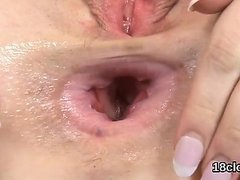 Fervent nympho is gaping wet twat in close-up and having org