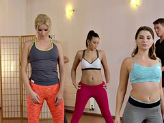 Yoga teacher bangs two sexy students in the gym