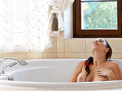 Connie fucks herself while taking a bath