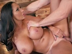 A girl with awesome tits is fucked on the table by her lover