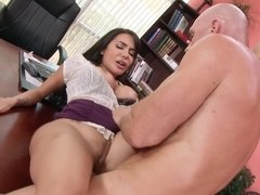 A brunette with firm boobs is fucked really hard in the office