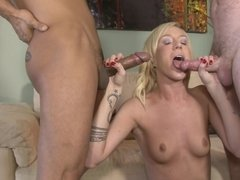 Two men are pounding this hot little blonde with small tits