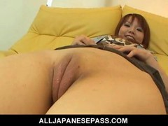Himena Ebihara Lovely Asiatic porn model is sitting on the sofa in her mini skirt. She has no panties so you can see her shaggy pussy. Her fella is th