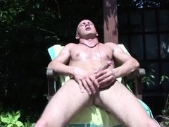 Hot dude Armani enjoys jacking off his dick under the sun