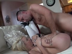 A sexy blonde with a bald pussy is having some fun with her man