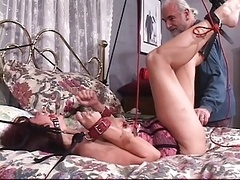 Brunette floozy gets her  nipples pinched while she bounded & gagged