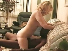 husband films his wife withe balck lad