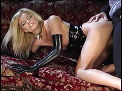 Stunning blonde in black latex gets deep drilling on a couch
