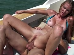 A bimbo with a bikini is on a boat where she is getting penetrated