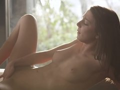 A brunette does some solo self penetrating with her fingers