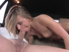 A blonde with a sexy ass is getting fucked in the back seat of the car