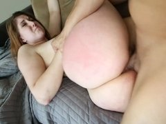 A brunette with a bunch of sexy tattoos is fucked on the sofa