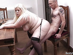 Blonde plumper in stockings rides boss's cock