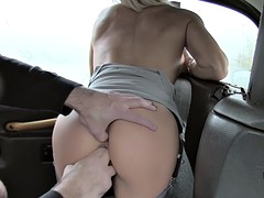 Blonde bangs in cab for a ride to destination