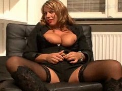 German dame has an intercourse herself in stockings and boots