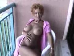 Aroused British mature redhead masturbating