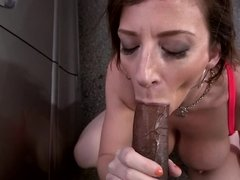 Brunette with a big ass is licking a black dick by a car outside