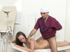 A sexy lady is getting fucked during her examination on the table