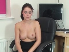 A slim woman with a nice rack is using a large vibrator on her pussy