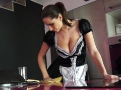 A busty maid is opening her legs to receive a dick between them