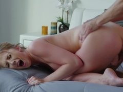 A blonde with nice tits is getting penetrated really hard on the sofa