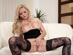 A blonde removes her top and then she massages herself for us