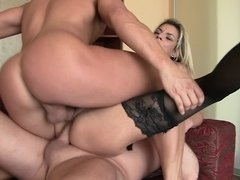 Double penetrated slut wears a corset and stockings for them