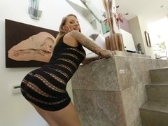A big ass blonde does a blow job in front of us in a sexy way