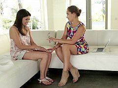 Playful lesbo BFFs on a couch