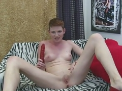 Short-haired broad fills herself with a vibrator