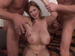 A redhead that has large tits is getting her pussy and ass fucked