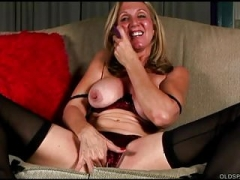 Saucy grown-up spunker in stockings loves to fuck her juicy vag