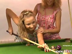 Gals licking on the billiards table