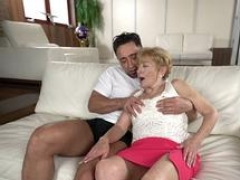 Aroused granny fucked by a stud