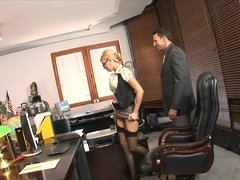 A woman is getting penetrated in the office by her large boss
