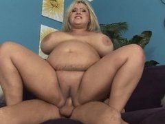 A fat woman that has huge tits is getting a dick in her meaty pussy