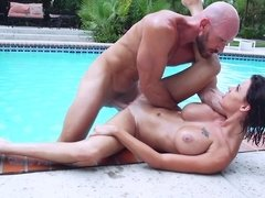 A sexy chick is getting wet and licked by the swimming pool