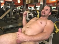 Two people are having a really hot workout in the gym together