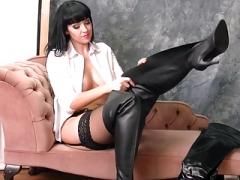 Kinky brunette in leather boots nylons panties suspenders