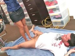Busty bitch uses her feet on a salesman