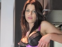 A beauty strips naked and then she plays by herself in the kitchen