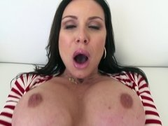 A milf with large tits is pushing her face against a large dick