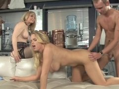 Two blondes are in a threesome in which they get fucked hard