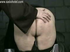 Glamorous nun with her skirt up is bending over and also is spanked on her ass by master priest