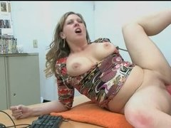 A large breasted lady is getting penetrated on the desk by the computer